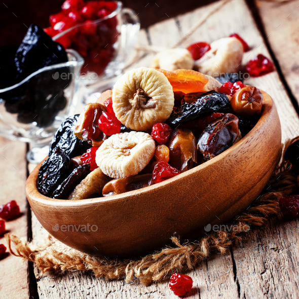 Dried figs, dried apricots, raisins, dates, prunes and cherries - Stock Photo - Images