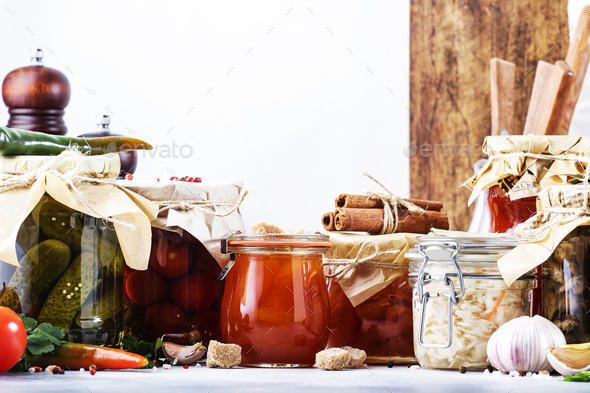 Canned food concept. Fermented, pickled, marinated preserved vegetarian food - Stock Photo - Images