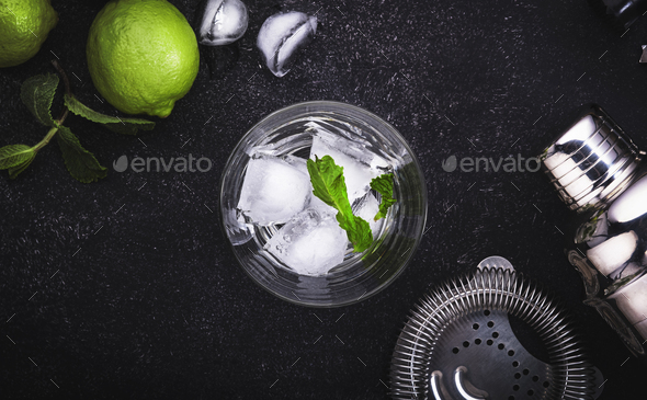 Bar tools. Ingredients for mojito cocktail with lime, mint leaves, ice - Stock Photo - Images