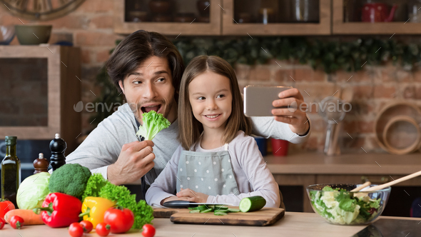Joyful Dad Taking Selfie On Smartphone With Little Daughter In Kitchen - Stock Photo - Images