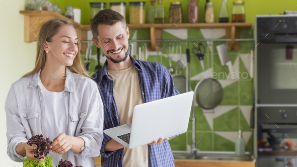 Couple cooking healthy food at house kitchen, preparing lunch - Stock Photo - Images