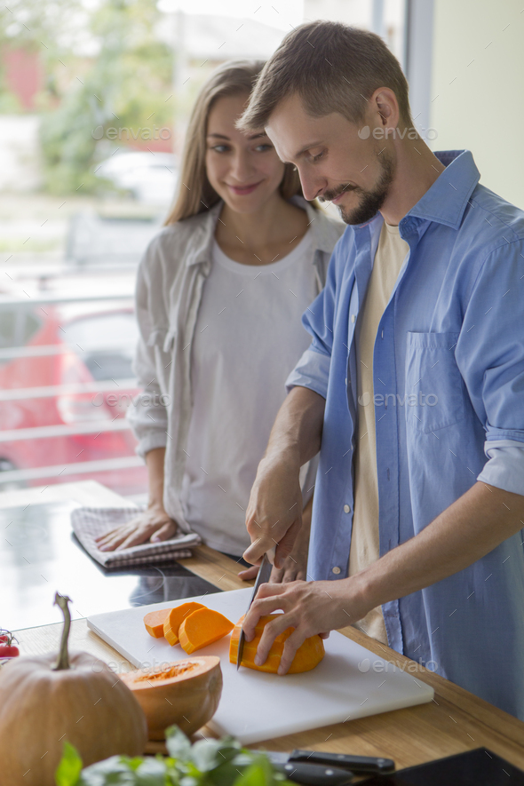 Happy vegetarian couple cooking of healthy products - Stock Photo - Images