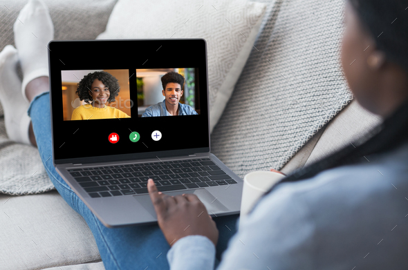 Black Woman Having Online Video Call On Laptop With Friends - Stock Photo - Images