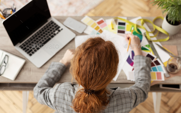 Young female fashion stylist working at home - Stock Photo - Images