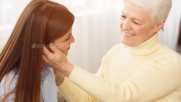 Mother tenderness. Happy mom and daughter spending time together - Stock Photo - Images