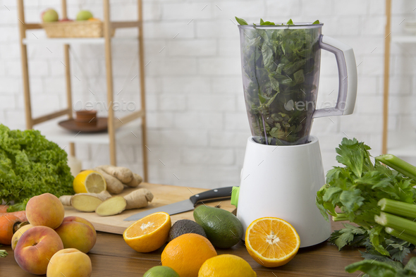 Blender with healthy smoothie and ingredients on table - Stock Photo - Images