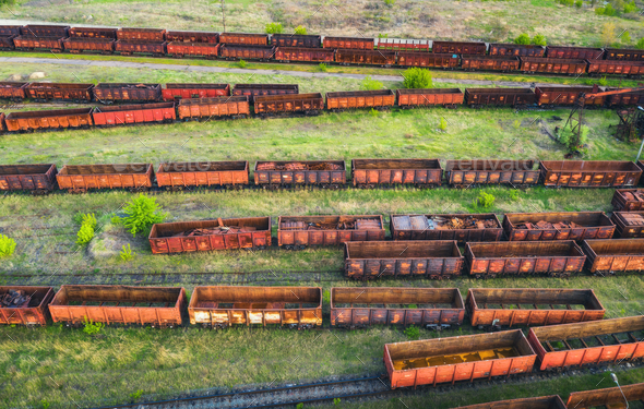 Aerial view of freight trains. Top view of old rusty wagons - Stock Photo - Images