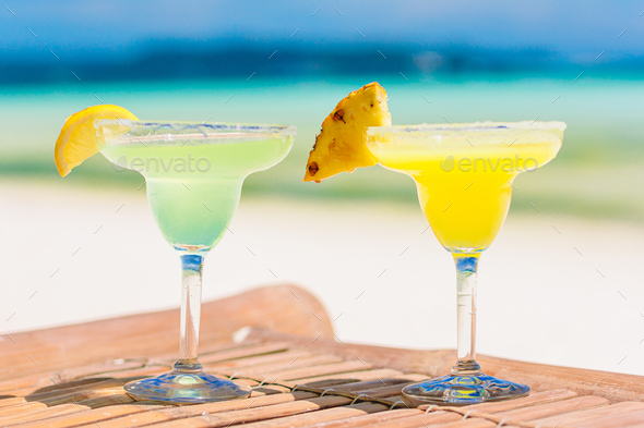 Two tasty cocktails on tropical white beach - Stock Photo - Images