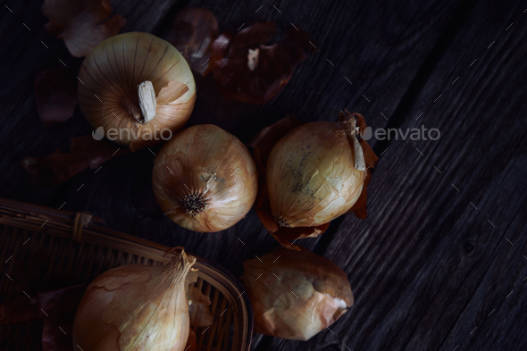 The onion on rusty wooden table - Stock Photo - Images