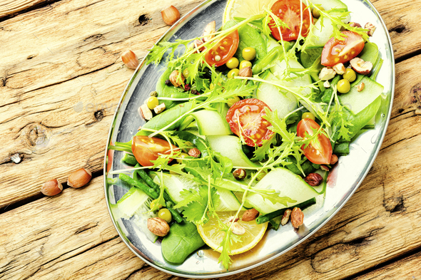 Plate of salad with vegetables and greens - Stock Photo - Images