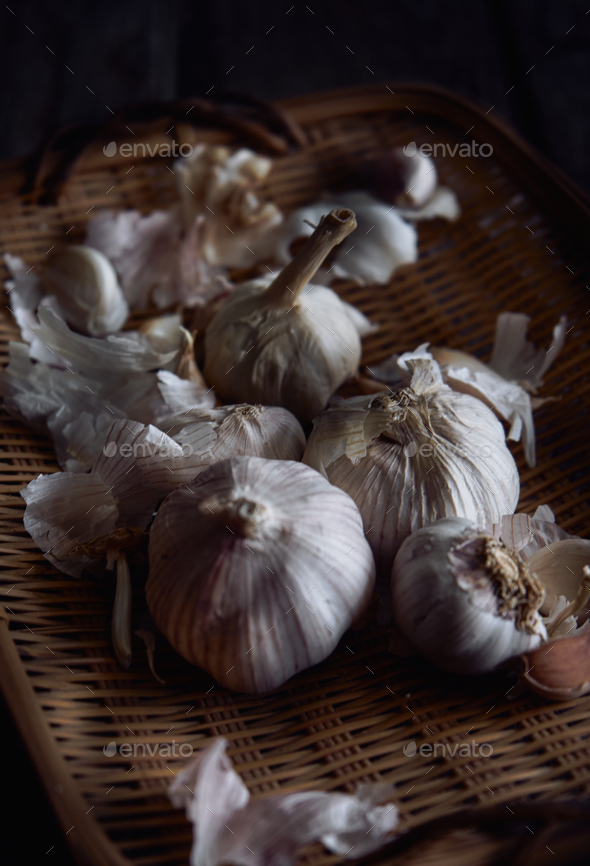 The garlic in a bamboo basket - Stock Photo - Images