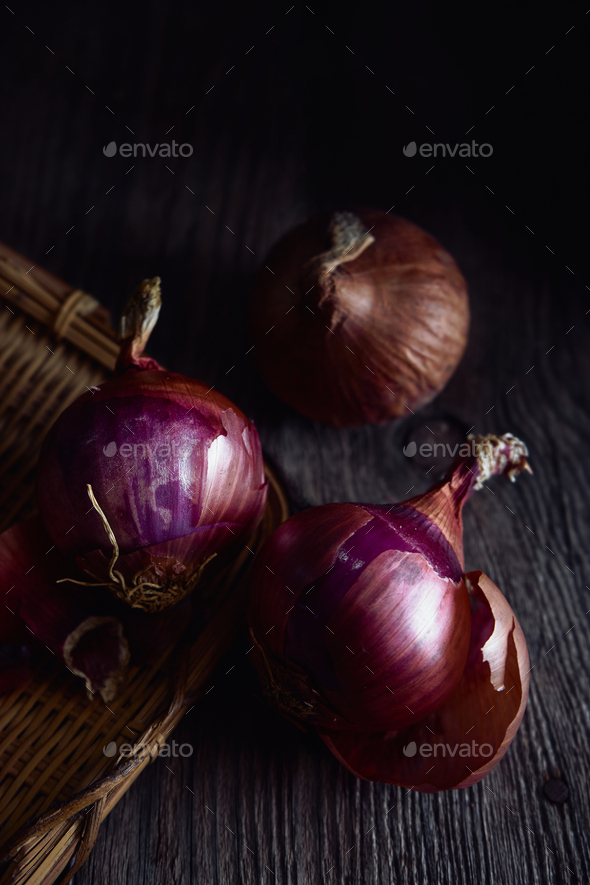 The red onions on rusty wooden table - Stock Photo - Images