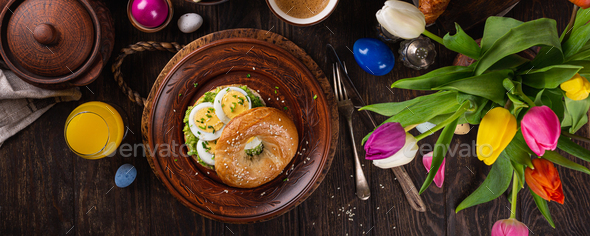 Healthy freshly baked bagel filled with eggs - Stock Photo - Images