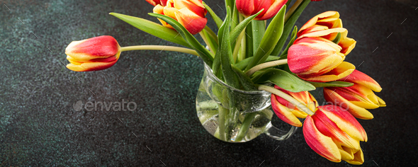 Red yellow tulips in glass vases - Stock Photo - Images