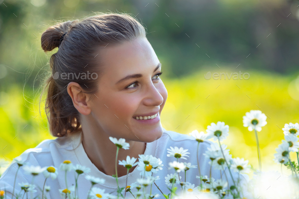 Happy young woman on flower field - Stock Photo - Images
