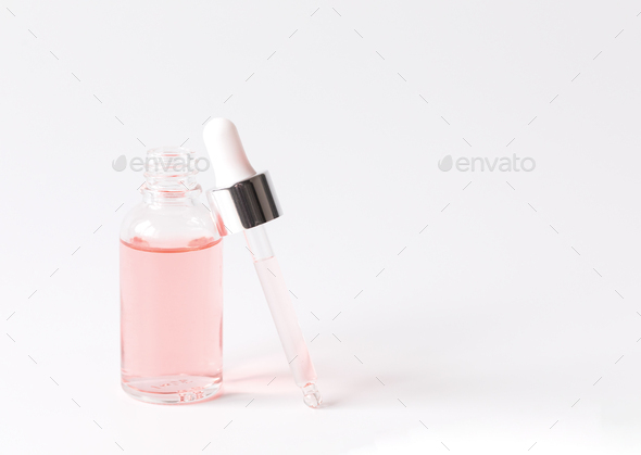Dropper Bottle with a pipette and pink water.Organic SPA cosmetics .Mock-Up. - Stock Photo - Images