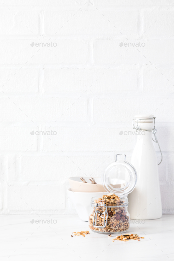 Granola, muesli with vegetable milk. Breakfast, snack.Concept of healthy and dietary nutrition. - Stock Photo - Images