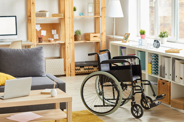 Modern room with wheelchair - Stock Photo - Images