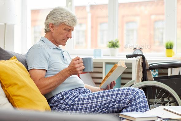Senior man reading a book - Stock Photo - Images