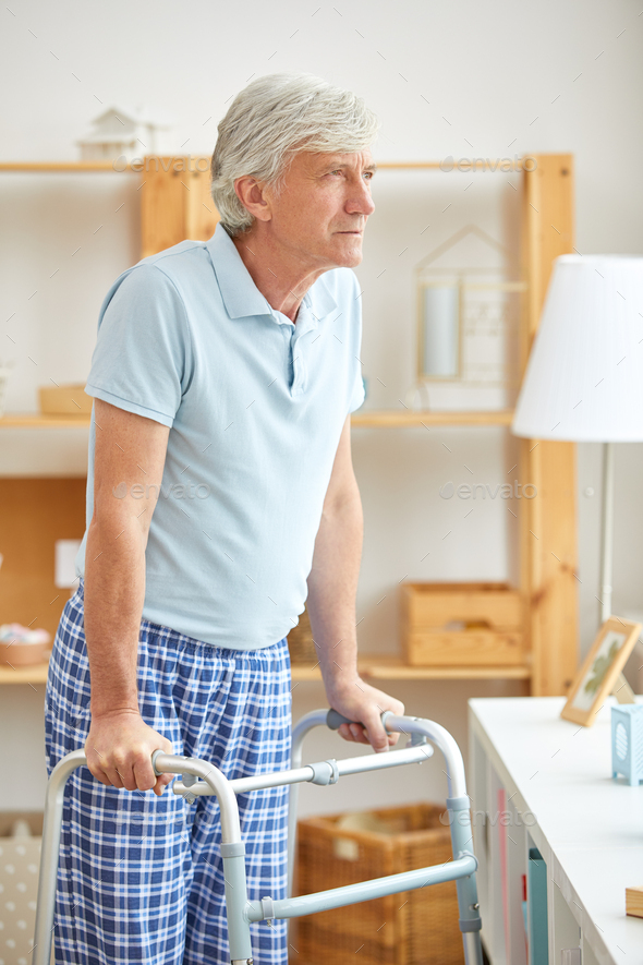 Senior man with walker at home - Stock Photo - Images