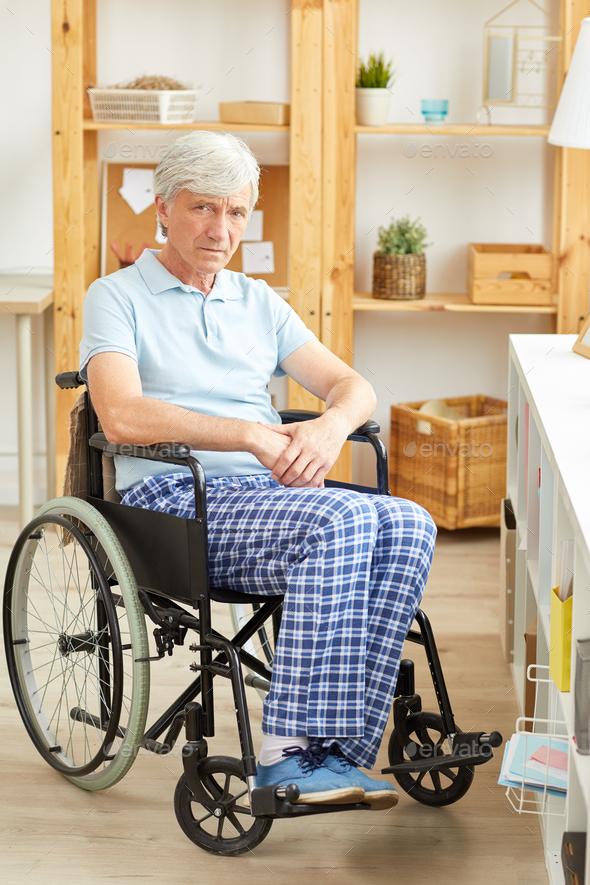Senior man in wheelchair - Stock Photo - Images