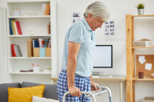 Man walking with walker - Stock Photo - Images