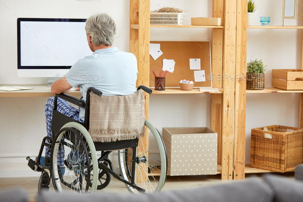 Disabled man watching TV - Stock Photo - Images
