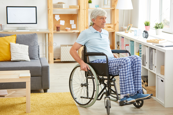 Disabled man in domestic room - Stock Photo - Images