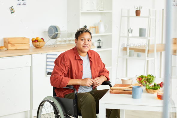 African disabled woman in the kitchen - Stock Photo - Images