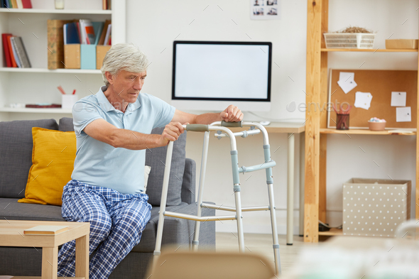 Man trying to stand up - Stock Photo - Images
