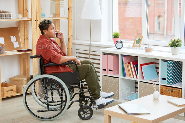 Disabled woman talking on the phone - Stock Photo - Images