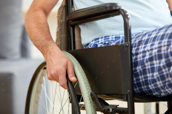Senior man riding on wheelchair - Stock Photo - Images