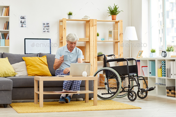 Senior man has leisure time at home - Stock Photo - Images