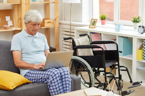 Senior man using laptop - Stock Photo - Images