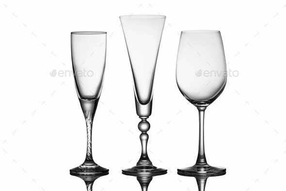 Three elegant stemmed glasses of different shapes - Stock Photo - Images