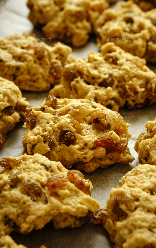 Freshly baked batch of raisin and sultana cookies - Stock Photo - Images