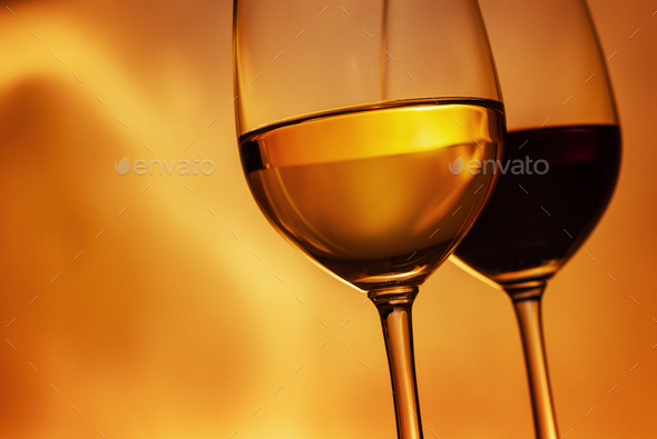 Tilted angle wineglasses with red and white wine - Stock Photo - Images