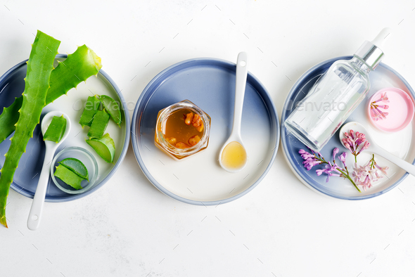 Natural ingredients for making cosmetic homemade lotion or essential oil on a light grey background - Stock Photo - Images