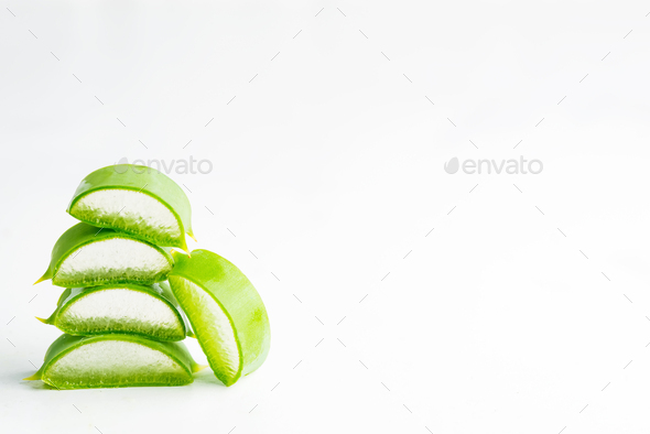 Close-up natural organic aloe vera plant sliced for homemade cosmetic liquid against white - Stock Photo - Images