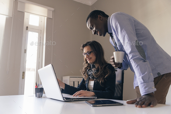 Young Multi-Ethnic Couple Working. - Stock Photo - Images