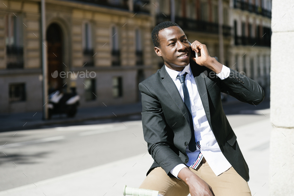 African man with mobile phone and bicycle. - Stock Photo - Images