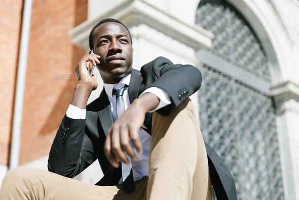 Handsome african man using his mobile. - Stock Photo - Images