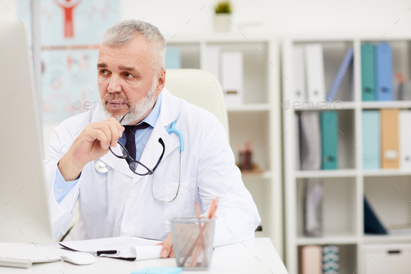 Experienced senior doctor at office - Stock Photo - Images