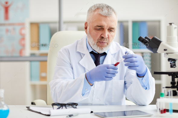 Scientist with medical sample - Stock Photo - Images