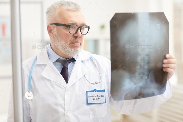 Doctor examining x-ray image - Stock Photo - Images