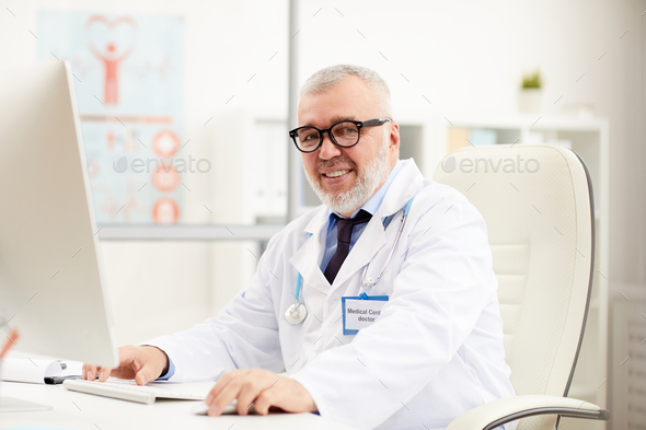 Doctor working on computer - Stock Photo - Images
