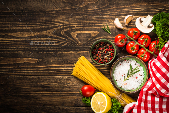 Food cooking background on wooden kitchen table - Stock Photo - Images