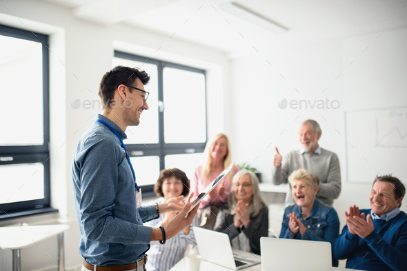 Group of senior people attending computer and technology education class - Stock Photo - Images