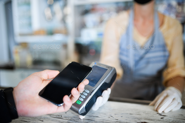 Contactless payment with smartphone, coffee shop open after lockdown - Stock Photo - Images