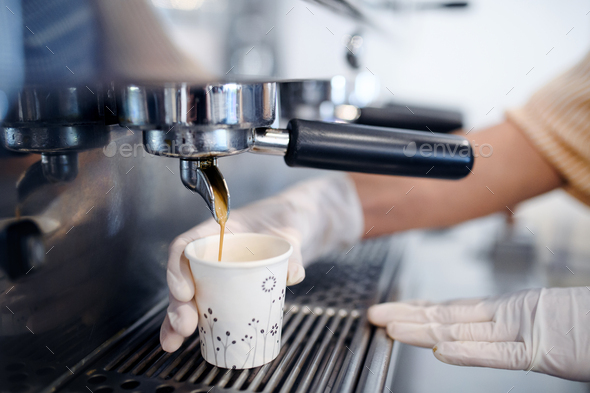Unrecognizable woman working with gloves, coffee shop open after lockdown quarantine - Stock Photo - Images